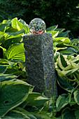 Glass ball on granite cube