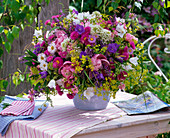 Bouquet from Erigeron, Campanula, Paeonia