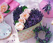 Arrangement of roses and lavandula in a box in heart shape