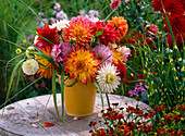Bouquet of different Dahlia and Miscanthus in pitcher