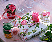 Roses on and wrapped around gift in cloth with rose motifs