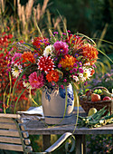 Autumn bouquet with dahlia, aster, miscanthus