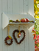 Small wooden shelf with aesculus (chestnut) heart and wreath