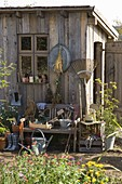 Garden shed in the garden, garden tools, clay pots and other utensils