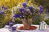 Autumn bouquet of Aster, Aconitum, grasses
