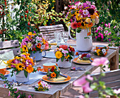 Table decoration with bouquets of Heliopsis, Helianthus