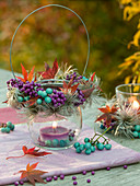 Lantern with purple and turquoise berries