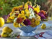 Autumn bouquet in enamel strainer