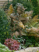 Cherub with lute, overgrown with hedera (ivy)