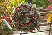 Autumn wreath with rose hips and eucalyptus