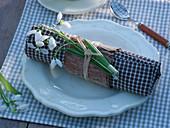 Galanthus nivalis (snowdrop) on napkin ring made of bark