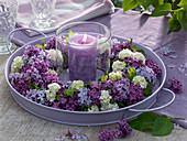 Candle wreath made of syringa (lilac) and viburnum (snowball)