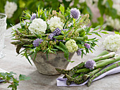 Arrangement made of viburnum opulus (snowball), Allium schoenoprasum