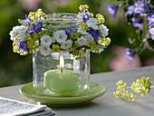 Screw cap glass as a lantern with a small wreath of Campanula carpatica