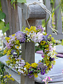 Small wildflowers wreath hanged on armrest