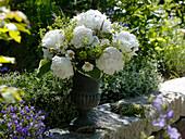Iron vase with a bouquet of Paeonia, Leucanthemum vulgare
