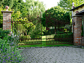Garden view through wrought-iron gate