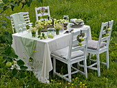 Apple table decoration in the summery meadow