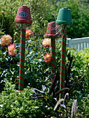 Colorfully painted clay pots on piles as beneficial shelter