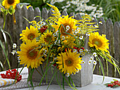 Late summer arrangement in wooden carrier