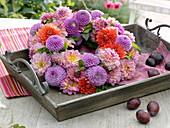 Wreath of jewelry dahlia and ball dahlia on wooden tray
