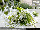 Fragrant wedding bouquet of lilies Funkie with grass bow