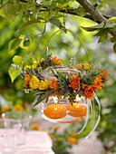 Mason Jar lantern with herb wreath