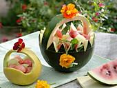 Melons carved as baskets for fruit salad