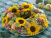 Late summer wreath with sunflowers and apples
