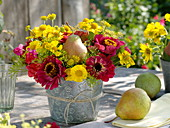 Red-yellow late summer bouquet with pear