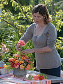 Woman inserts late summer bouquet