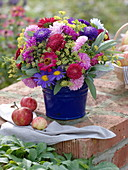 Late summer bouquet with summer asters, zinnias and herbs