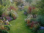 Autumnal beds with grasses, perennials, summer flowers and shrubs