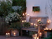 White evening terrace with lanterns and candles