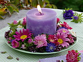 Violet candle in late summer wreath