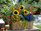 Autumn basket with sunflowers and perennials