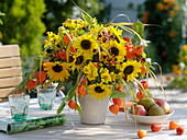 Late summer bouquet with sunflowers and physalis