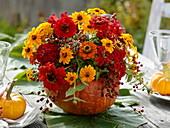 Hollow pumpkin as a vase with bouquet