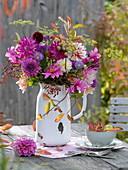 Autumn dahlias bouquet in enamelled jug