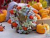 Small wreath of hydrangea flowers and lantern flower