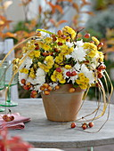 White-yellow autumn bouquet with ornamental apples