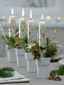Unusual Advent wreath of individual ceramic cups in series