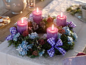 Unusual Advent wreath of mixed coniferous green with flowers