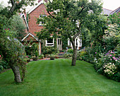 WELL-Kept LAWN & Patio / TERRACE at BACK of HOUSE with ALPINE TROUGHS. Designer: MALLEY Terry