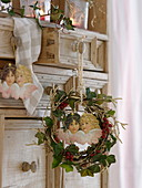 Small wreath of hedera, betula, branches gilded