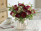 Wintery bouquet of roses with wax flower and eucalyptus