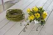 Yellow daffodil bouquet in wreath of dogwood branches