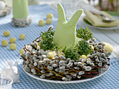 Easter table decoration with cress eggs and pussy willow
