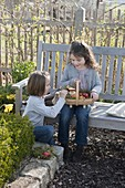Girl look for easter eggs in the farm garden