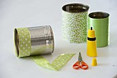Tin cans spiced up with green ribbon